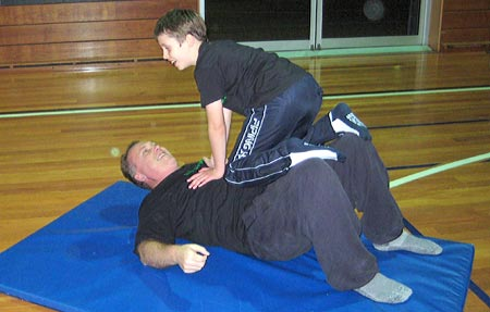 Child and dad exercising at a HDHK session