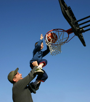 Dad with son on basketball ring