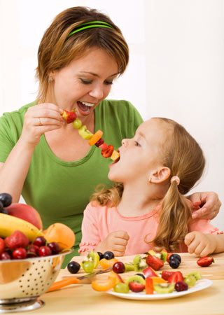 Mother and child eating healthy food